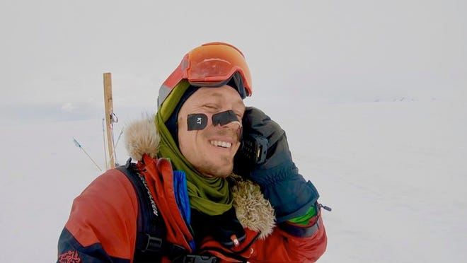 In this photo provided by Colin O'Brady, of Portland., Ore., he speaks on the phone in Antarctica on Wednesday, Dec. 26, 2018. He has become the first person to traverse Antarctica alone without any assistance. O'Brady finished the 932-mile (1,500-kilometer) journey across the continent in 54 days, lugging his supplies on a sled as he skied in bone-chilling temperatures.