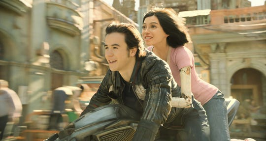 """After waking up in a future world with no memories, cyborg heroine Alita (Rosa Salazar, with Keean Johnson) tries to find freedom in the sci-fi action film """"Alita: Battle Angel."""""""