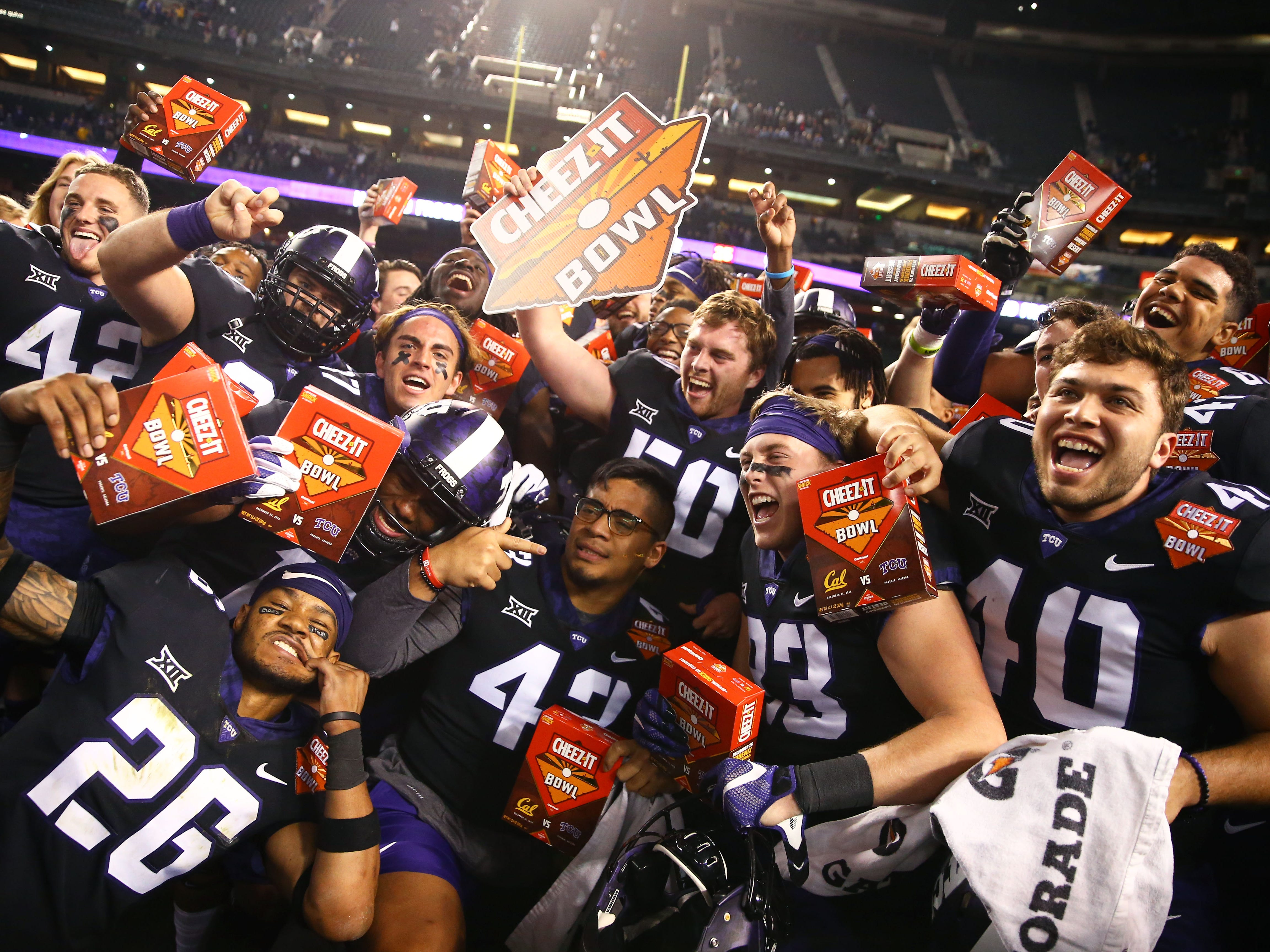TCU players celebrate after defeating California, 10-7, in overtime of the Cheez-It Bowl at Chase Field.