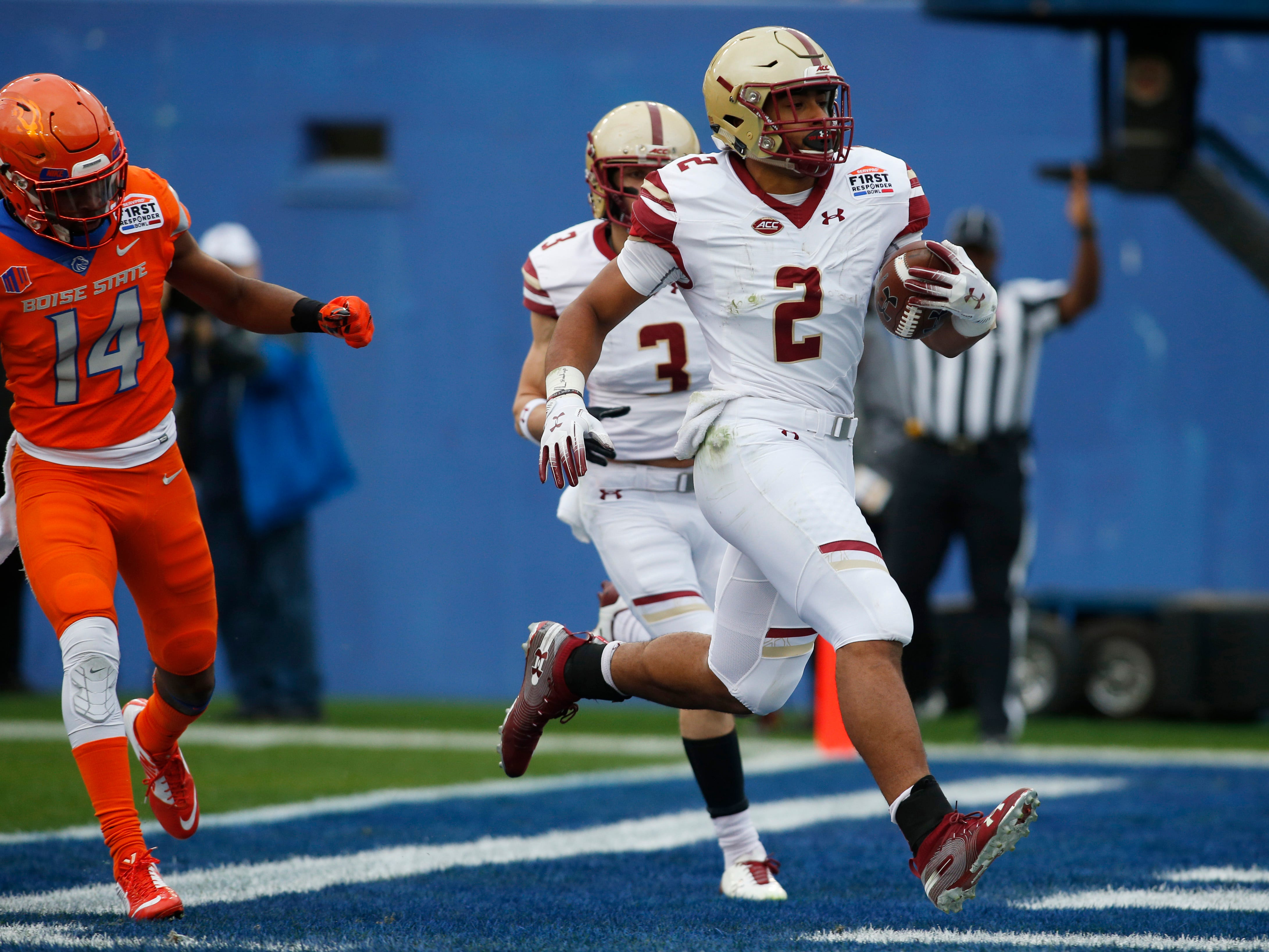 Boston College running back AJ Dillon scores a touchdown in the first quarter against Boise State  in the First Responder Bowl in Dallas. The play, however, didn't count because the game was  canceled.