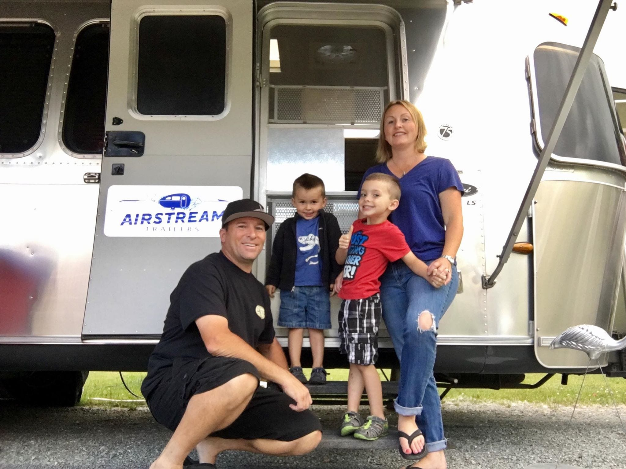 (From left to right) Dean, Jett, Gage and Rebecca Machado posed in front of their 2006 Airstream in Acampo, CA.
