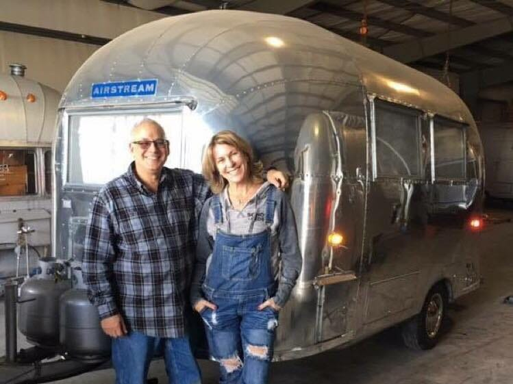 Margi (right) and Robert Sivek (left) own a 1961 Airstream Bambi