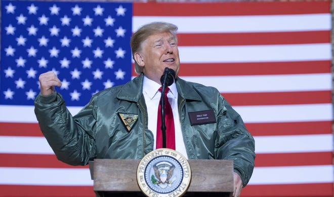 President Donald Trump speaks to members of the military during an unannounced trip to Al Asad Air Base in Iraq, Dec.26, 2018.