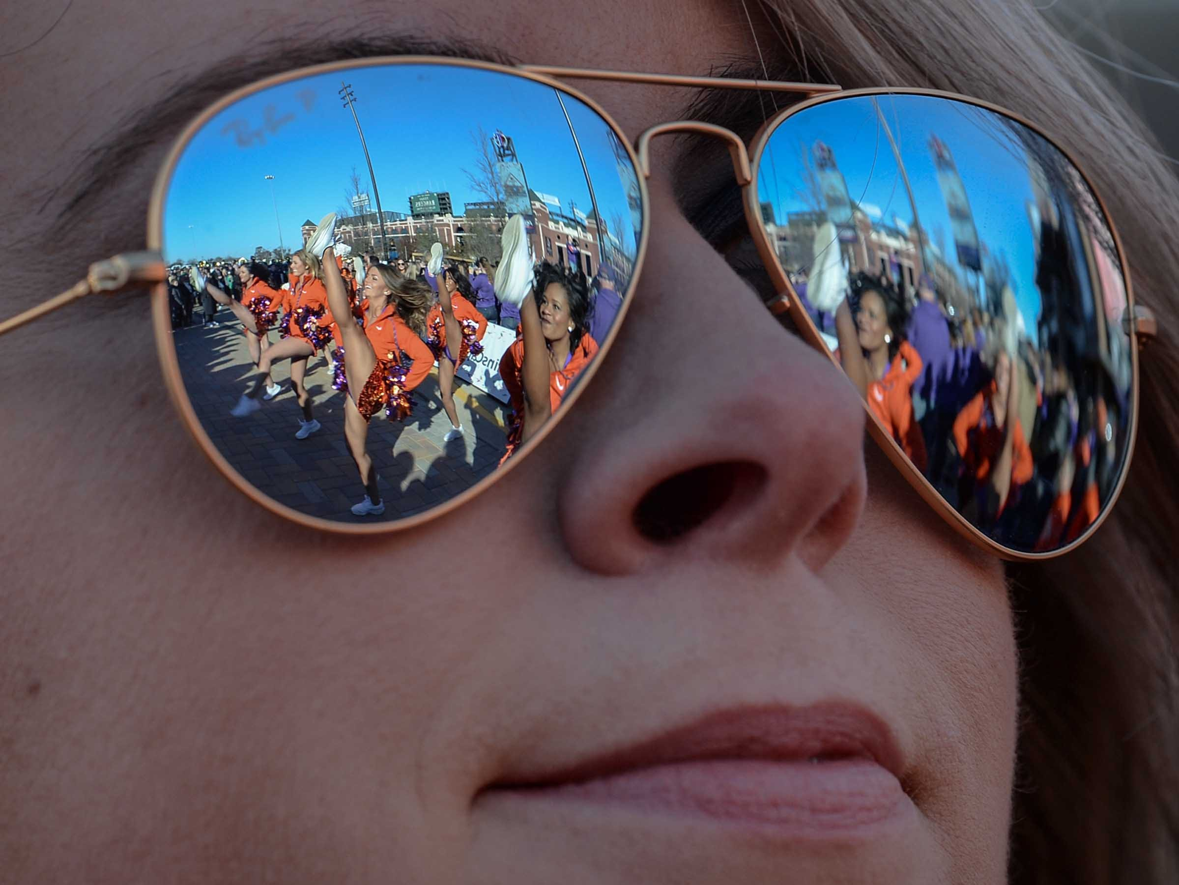 Rally Cats dance in the reflection of sunglasses of Anna Low of Tuscaloosa, Alabama, at the Battle of the Bands competition in Arlington, Texas December 28, 2018.