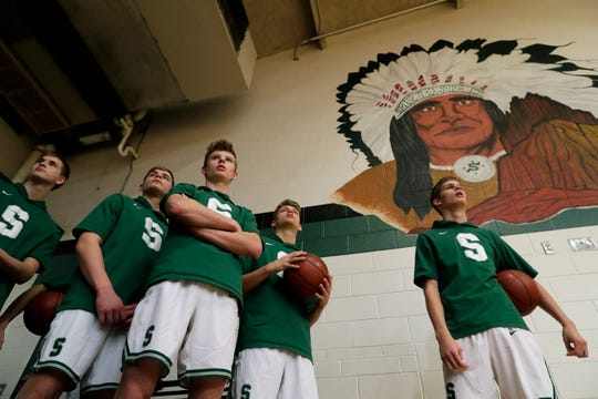 Shiocton High School's players wait to take to the court against Sturgeon Bay High School during their boys basketball game Thursday, Dec. 27, 2018. in Shiocton. A proposed resolution would've made strides toward retiring all Native American mascots and nicknames used in Wisconsin public schools, but it failed Wednesday at the Wisconsin Association of School Boards annual convention in Milwaukee.