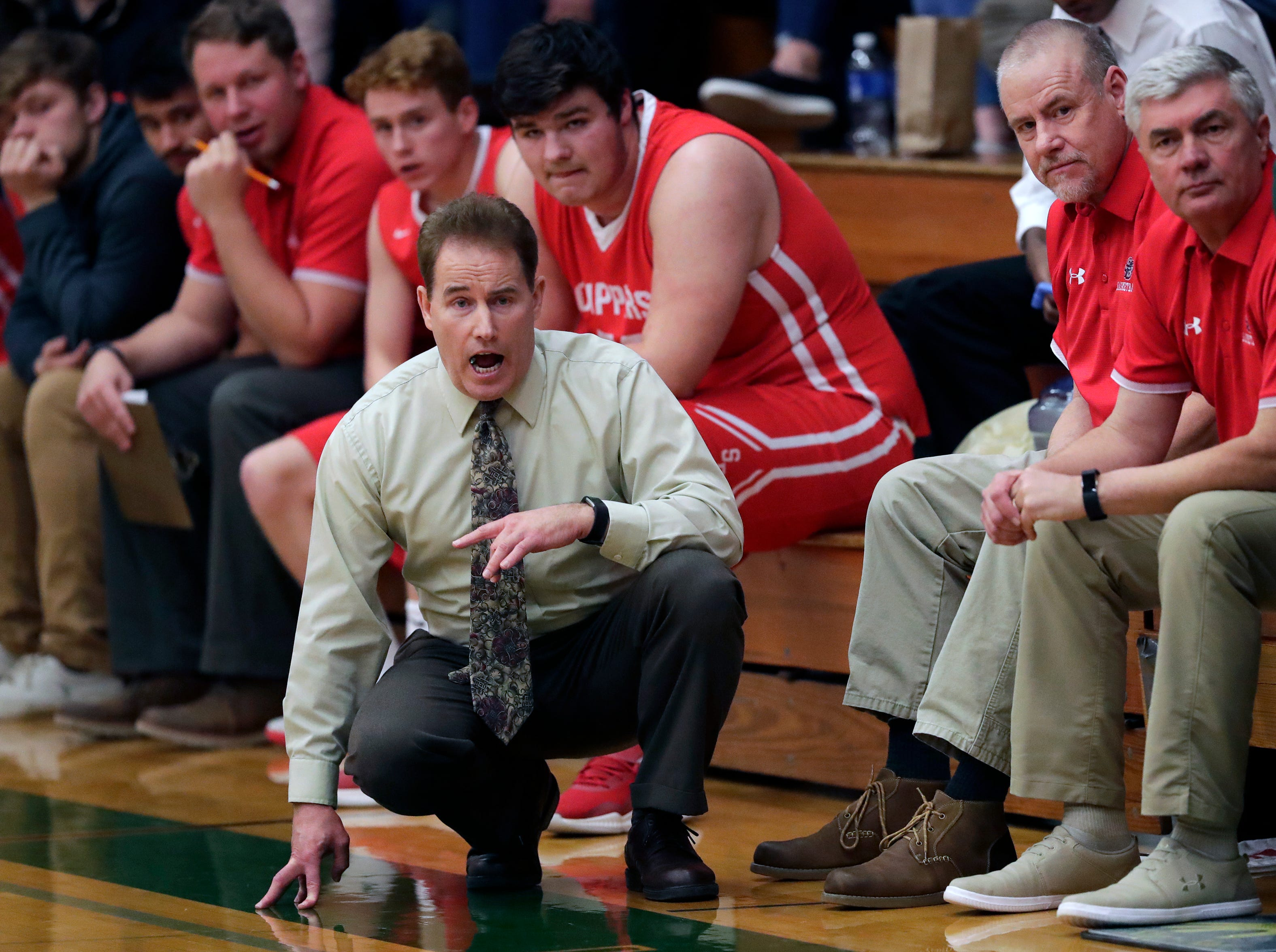 Sturgeon Bay High School's coach Jim Benesh leads his team against Shiocton High School during their boys basketball game Thursday, December 27, 2018, in Shiocton, Wis. 