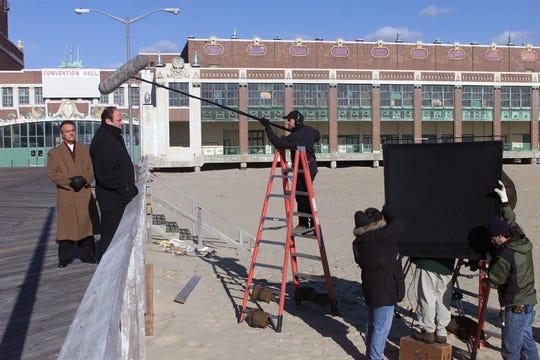 "James Gandolfini, center, and Tony Sirico, left, prepare to film a scene for ""The Sopranos"" while on the boardwalk in Asbury Park on Dec. 12, 2000."