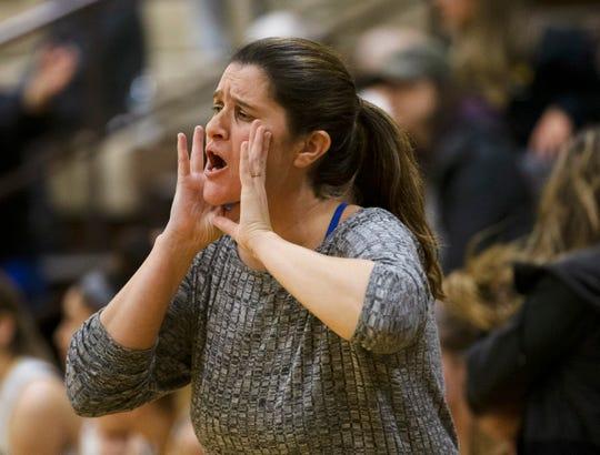 St. John Vianney coach Dawn Karpell  yells instructions to her team. St. John Vianney Girls Basketball vs The Patrick School in Holmdel, NJ on December 28, 2018.