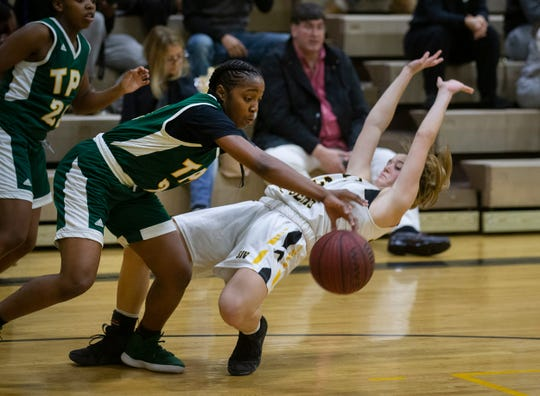 SJV's Sarah Karpell gets knocked down by Patrick School's Lashae Dwyer during second half action. St. John Vianney Girls Basketball vs The Patrick School in Holmdel, NJ on December 28, 2018.