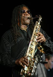 Clarence Clemons performs at the Paramount Theatre in Asbury Park on Nov. 29, 2002.