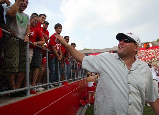 Rutgers graduate James Gandolfini reacts to fans as Rutgers upset Michigan State in the Setp. 4, 2004 Rutgers football season opener at Rutgers Stadium in Piscataway.