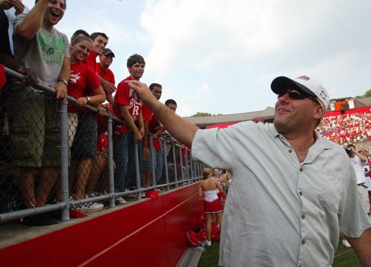 Rutgers graduate James Gandolfini reacts to fans as Rutgers upset Michigan State in the Setp. 4, 2004 Rutgers football season opener at Rutgers Stadium in Piscataway.
