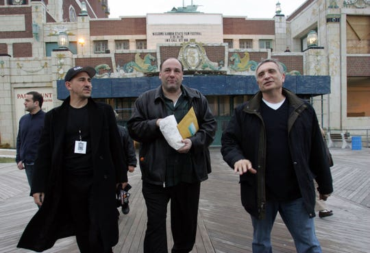 "James Gandolfini (center) walking from the Paramount Theater to the Howard Johnson building for a press conference with director Paul Carafotes and Gary Motolla after the screening of the film ""Club Soda"" at the Garden State Film Festival on March 24, 2007 in Asbury Park."