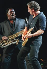 Bruce Springsteen, right, and Clarence Clemons perform to a sold-out crowd on June 26, 2000, at Madison Square Garden in New York.