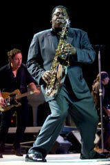 Clarence Clemons on the saxophone is backed up by Bruce Springsteen (left) and Little Steven Van Zandt during a June 12, 2000 concert at Madison Square Garden in New York.