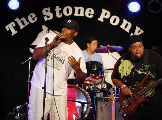Nick Clemons, left, leads his band at the Stone Pony in Asbury Park on Oct. 16, 2011.