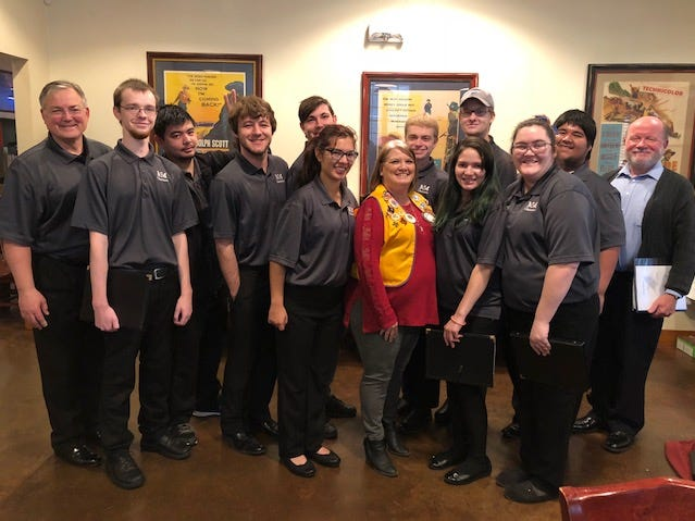Abilene Founders Lions Club president Darla Flatt (center) meets with the McMurry University Chanters, who presented a patriotic Christmas program at the club's Dec. 13 Christmas party. The Chanters were led by Dr. David Wallis (far left) and accompanied by Charles Shelton (far right).