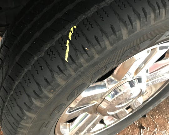 A freshly marked tire downtown on Wednesday, between bouts of rain.