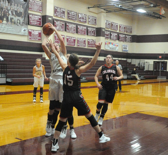 Haskell senior Taylor Manske (5) goes for a shot Friday morning over Colorado City's Kaci Hudson (15) at the Eula Holiday Classic.
