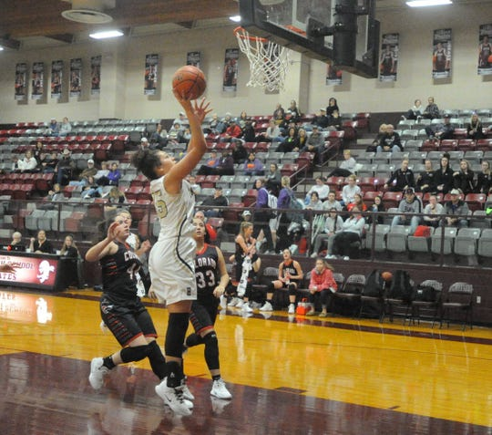 Haskell center C'Era Taylor makes a bucket in the lane Friday morning against Colorado City at the Eula Holiday Classic.