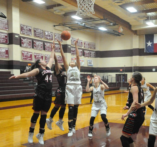 Haskell senior C'Era Taylor (45) grabs a rebound Friday morning over Colorado City's Haley Bridges (44) and Mia Monroe at the Eula Holiday Classic.