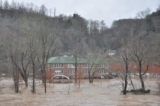 The French Broad River covered Blannahassett Island shortly after noon Friday, December 28, after river levels climbed seven feet in under 12 hours.