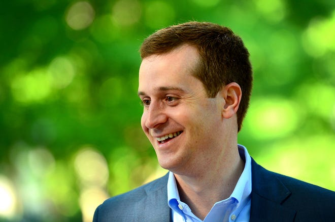 FILE - Int his May 8, 2018, file photo, Ninth Congressional district Democratic candidate Dan McCready smiles outside Eastover Elementary School in Charlotte, N.C. The North Carolina board investigating allegations of ballot fraud in a still-unresolved congressional race between McCready and Republican Mark Harris could be disbanded Dec. 28 under a state court ruling in a protracted legal battle about how the panel operates.