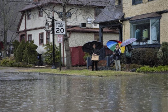 Several people were out and about checking the extent of the flooding in Biltmore Village Friday.