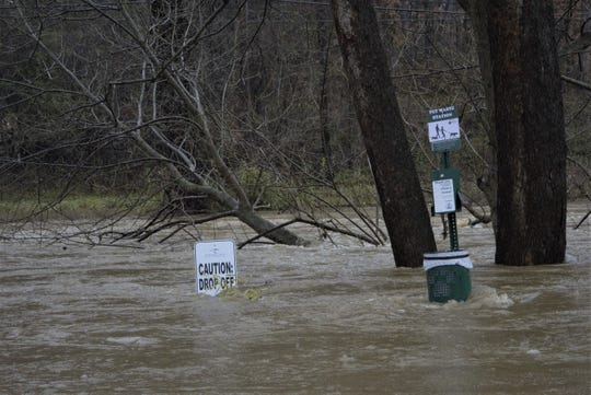 The Swannanoa River swallowed Swannanoa River Road Friday and everything near it.