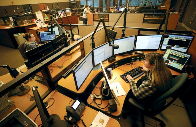 FILE — A 911 dispatcher handles calls in December 2018. Kitsap 911 is going to voters in November, asking them to approve an increase in the county's sales tax to pay for upgrades to what the agency says are outdated systems.