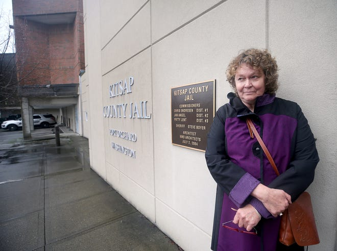Carol Carlson, of Edmonds, stands outside of the Kitsap County Jail in Port Orchard on Friday. In December 2017, State Patrol troopers accused Carlson of drunken driving, arrested her at the Kingston Ferry Terminal and took her to the jail. She wandered Kitsap for days after being released from jail, her family unable to locate her, and ended up at Harrison Medical Center, where she was diagnosed as having suffered a stroke.