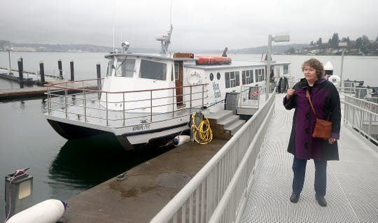 Carol Carlson of Edmonds, Washington, stands Dec. 28, 2018, at the Port Orchard, Washington, passenger ferry to Bremerton. In December 2017, State troopers took her to jail, accusing her of drunk driving. When she was released, she eventually wandered to the ferry.
