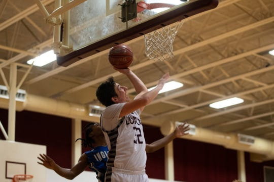 London's Joshua Chesney jumps to make a layup during their game against Ingleside at Calallen High School on Friday, Dec. 28, 2018.