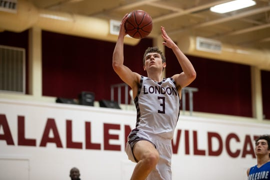 London's Salvador Gallardo jumps to make a layup during their game against Ingleside at Calallen High School on Friday, Dec. 28, 2018.