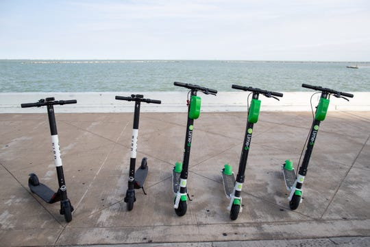Dockless rentable motorized scooters along North Shoreline Boulevard on Friday, Dec. 28, 2018.