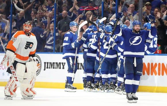 Nikita Kucherov (86) celebrates after winning as Philadelphia Flyers goaltender Michal Neuvirth (30) skate by at Amalie Arena. Mandatory Credit: Kim Klement-USA TODAY Sports