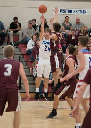 Senior Chad Ison scores three points during the first half of Zane Trace's game against Vinton County at Zane Trace High School Thursday evening.
