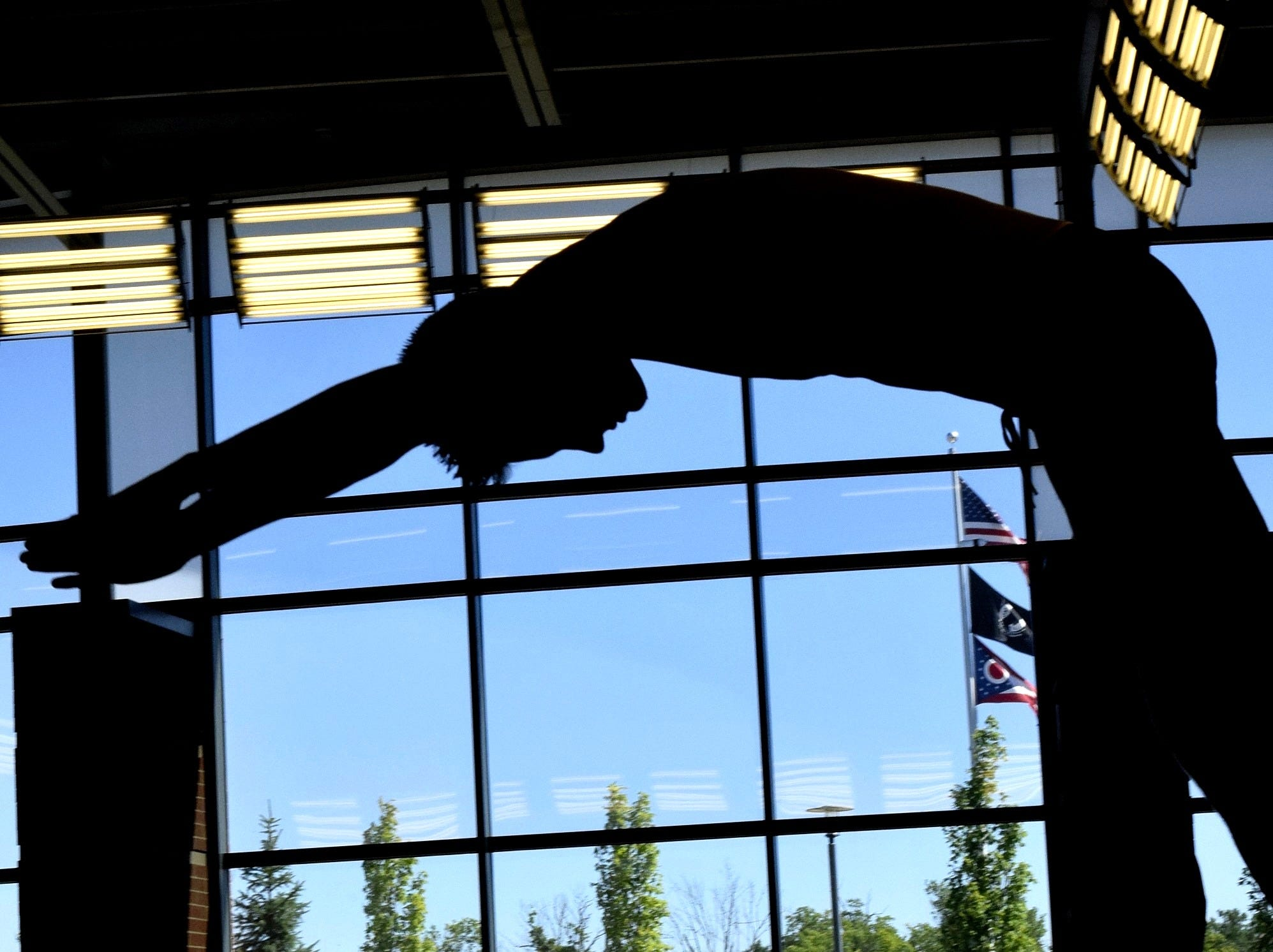 """The Cincinnati Moose 18U dive in the pool """"silhouette style"""" for action at the 8th Annual Jose Cerda Memorial Cincinnati Shootout Water Polo Tournament held at the Princeton High Natatorium, July 8, 2018."""