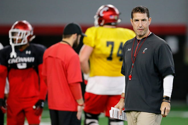 Cincinnati Bearcats head coach Luke Fickell paces between groups during a practice session at the University of Maryland's Cole Field House in College Park, Md., on Friday, Dec. 28, 2018.