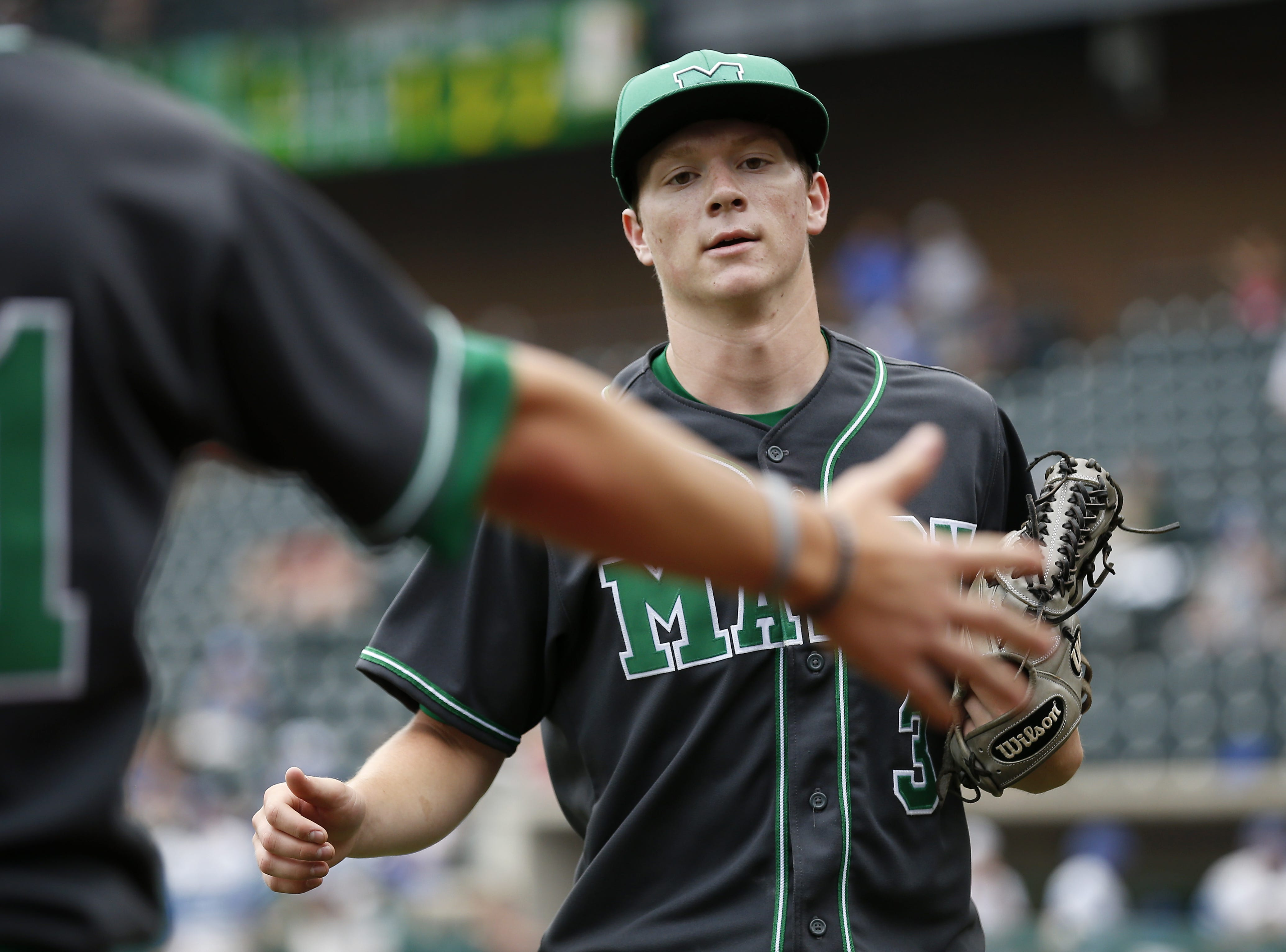 Mason Comets' Will Pfennig (3) returns to the dugout in the third inning of the OHSAA Div. I State Tournament semi-final baseball game between the Mason Comets and the Anthony Wayne Generals at Huntington Park in Columbus, Ohio, on Friday, June 1, 2018. The Anthony Wayne Generals advanced to the State Final with a 1-0 win over Mason.