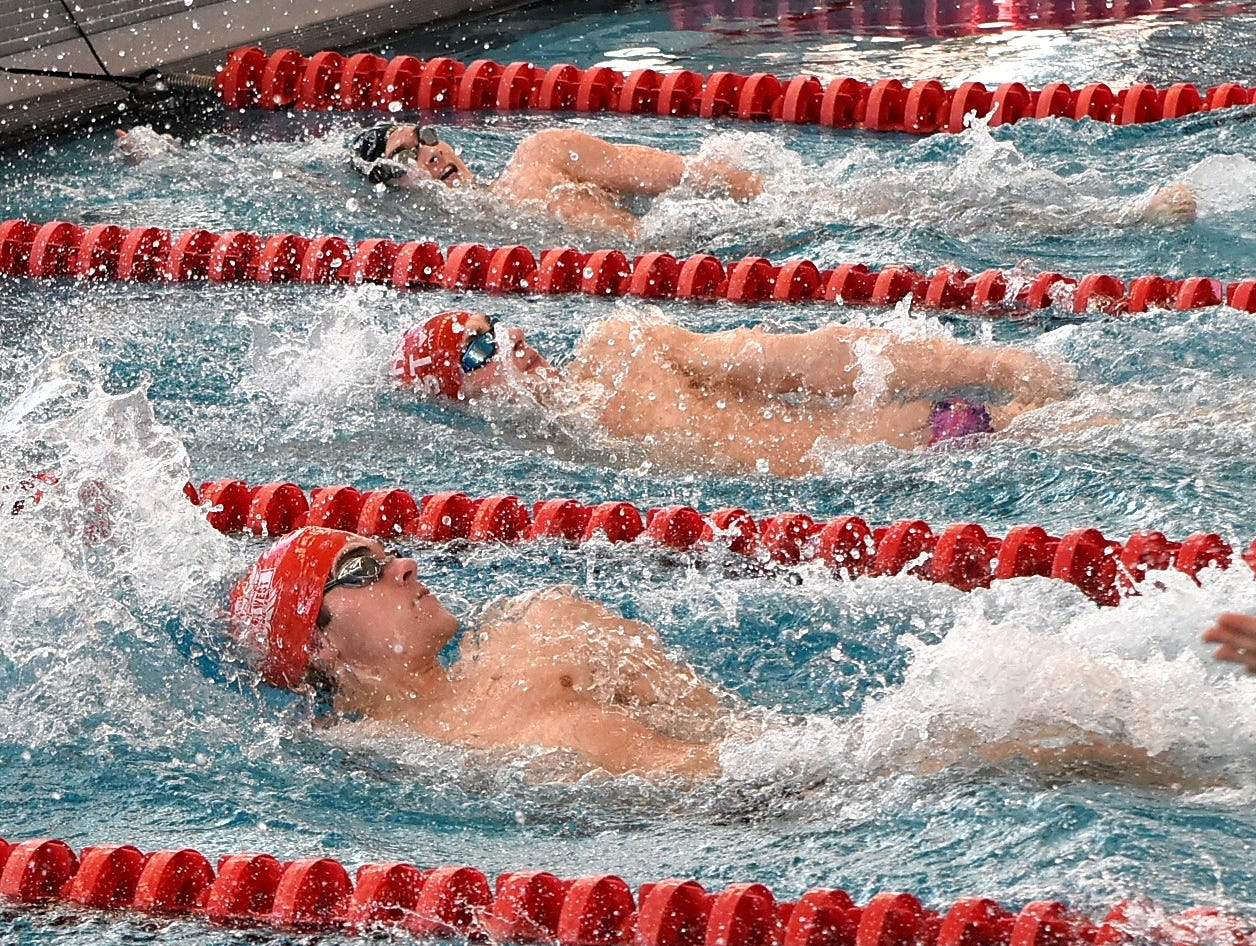 It's a 1,2,3 finish in Heat 4 of the Boys 100 Yard IM as Keith Enrico leads the way for Lakota East followed by Zachary Suarine and Jackson Ford of Lakota West at the Southwest Ohio Swimming and Diving Classic, Jan. 13, 2018.