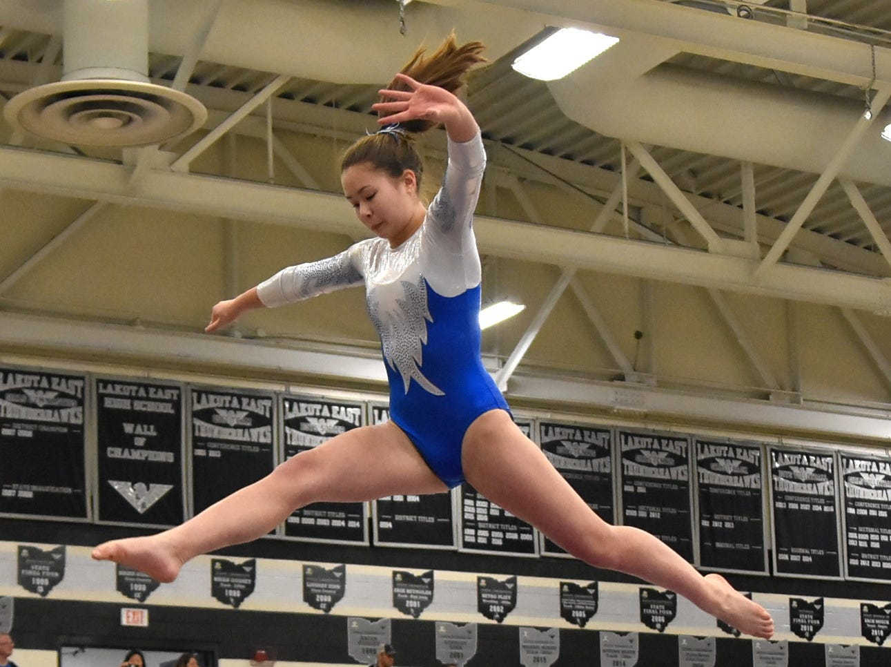 Seven Hills' Caroline Corbett scores high marks for her performance on the Beam at the 2018 Southwest Ohio District Gymnastics Championships, Feb. 24, 2018.