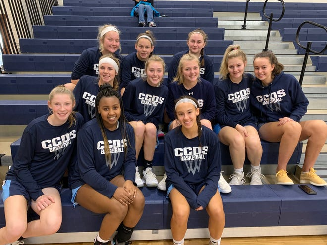 The Cincinnati Country Day girls team poses for a group picture at the Windermere Prep Rock Holiday Classic in Orlando, Florida.