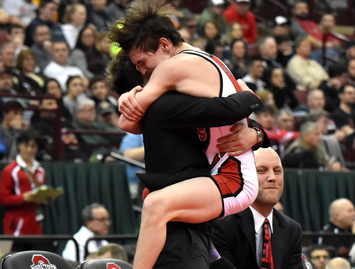 La Salle's Lucas Byrd makes the leap for joy into the arms of  his brother after capturing the 113 lbs. class state title at the OHSAA Division 1 State Individual Wrestling Championship, March 10, 2018.