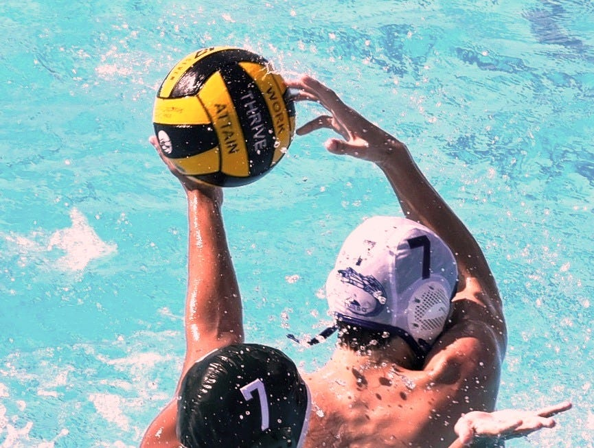 St. Xavier's Aiden Powers (7) whips a backhand shot to the goal over the Mason defense for the Bombers at the 2nd Annual Sunlite Shootout Water Polo Tournament held at Coney Island's Sunlite Pool, Sept. 15 & 16, 2018.