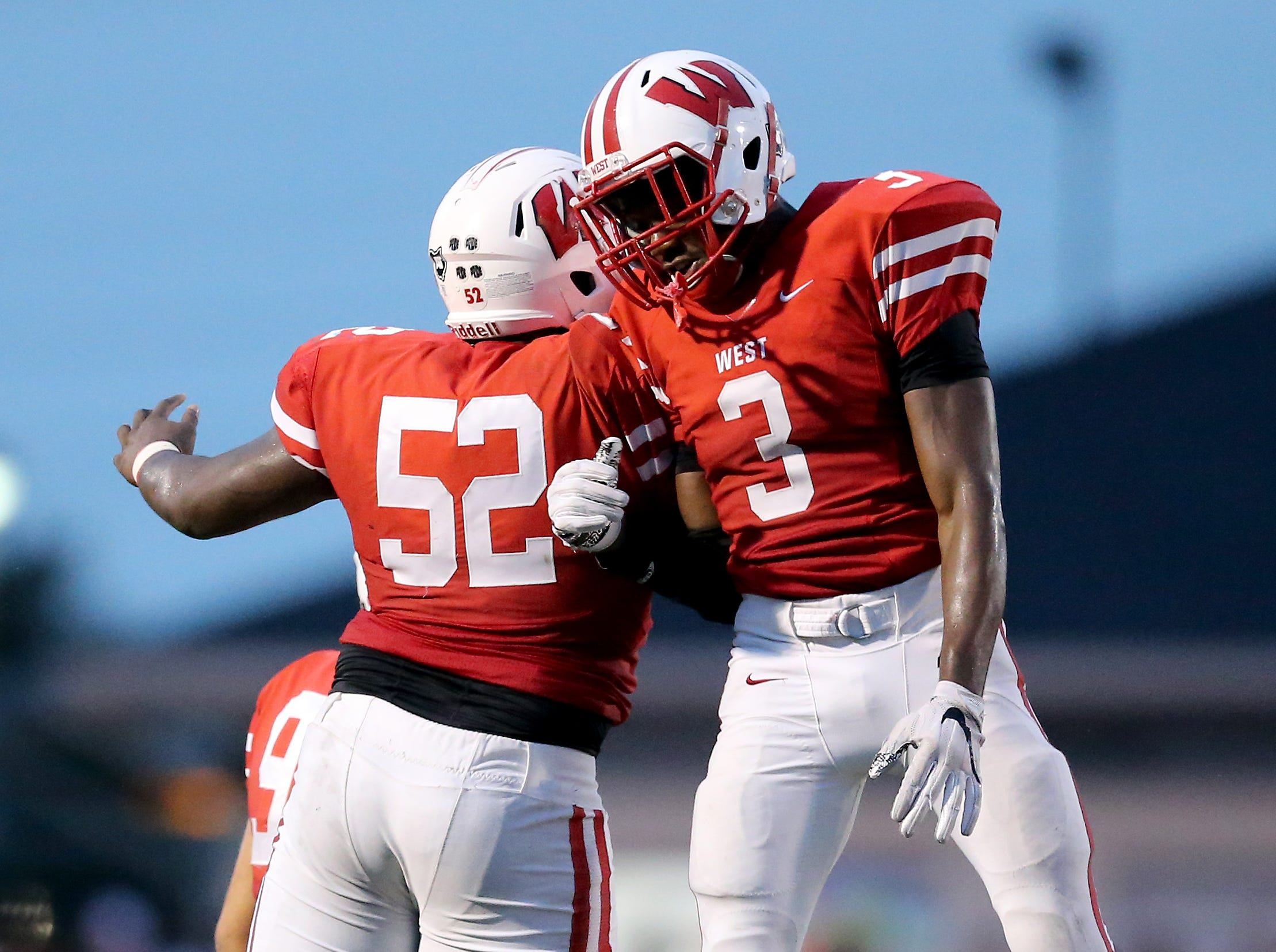 Lakota West Firebirds linebacker Jalen Swanson (3) celebrates a fumble recovery with defensive tackle Ladonnis Griffin (52) in the second quarter during a high school football game between the Oak Hills Highlanders and Lakota West Firebirds, Friday, Sept. 21, 2018, at Lakota West High School in West Chester Township, Ohio.