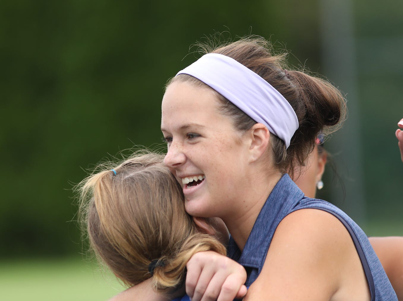 St. Henry's Lauren Mays celebrates after she qualified for the state tournament after a playoff hole during the regional girls golf tournament,  Thursday, Sept. 27, 2018.