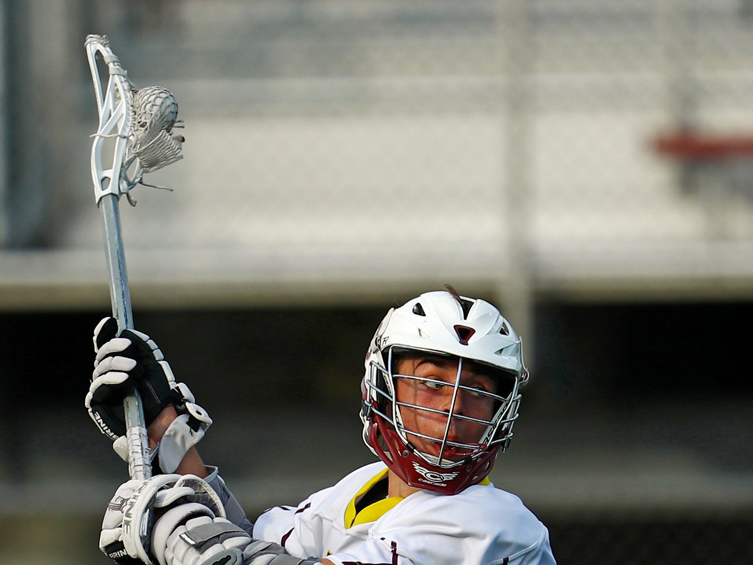 Turpin's Colin Peterman rips a shot toward the goal in the game between CHCA and Turpinlacrosse at Turpin High School. Turpin defeated CHCA 8-7.