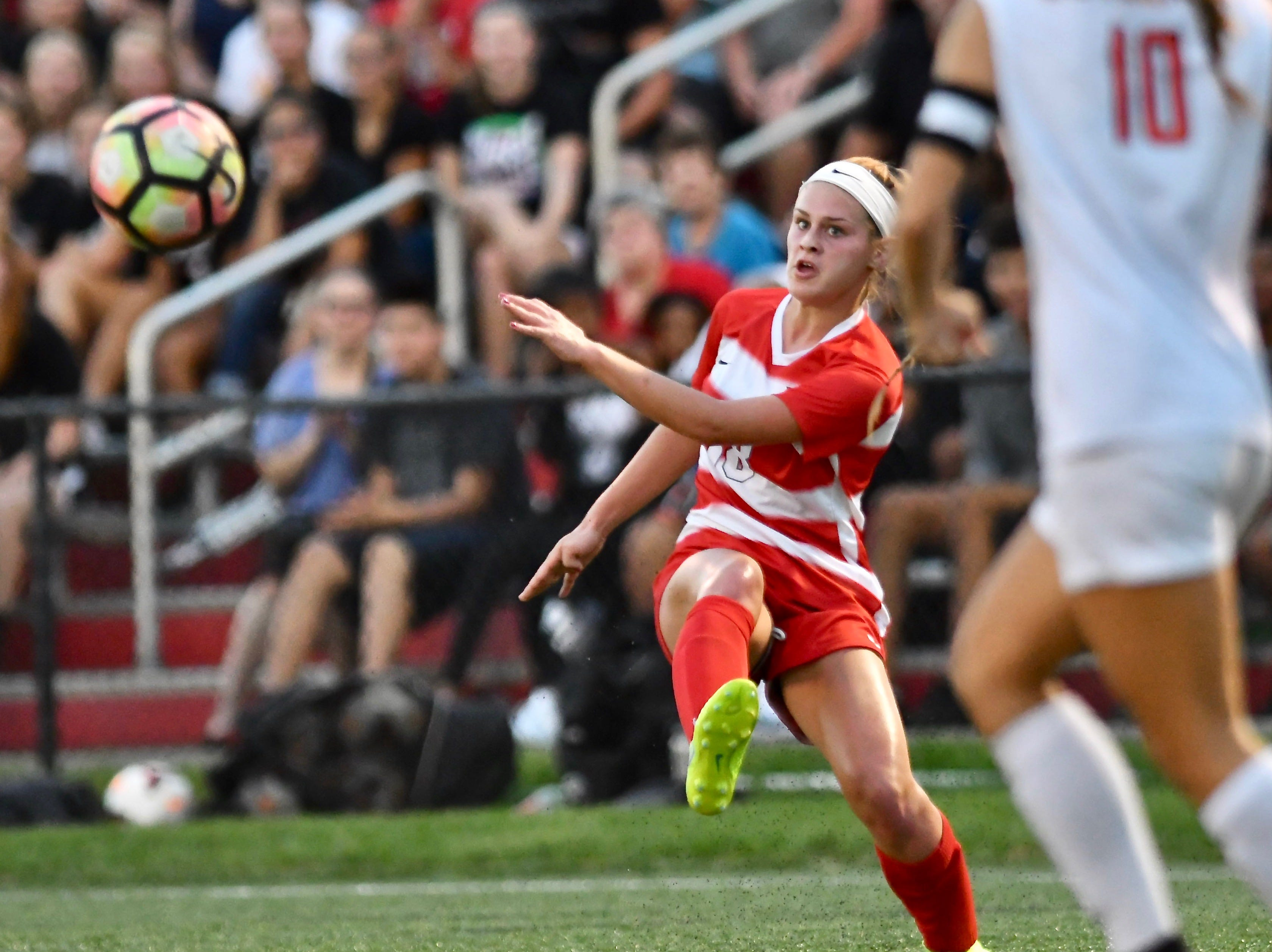 Fairfield's Isabelle Wissel crosses a ball into the Loveland box Thursday, Sept. 20, 2018 in Fairfield, Ohio