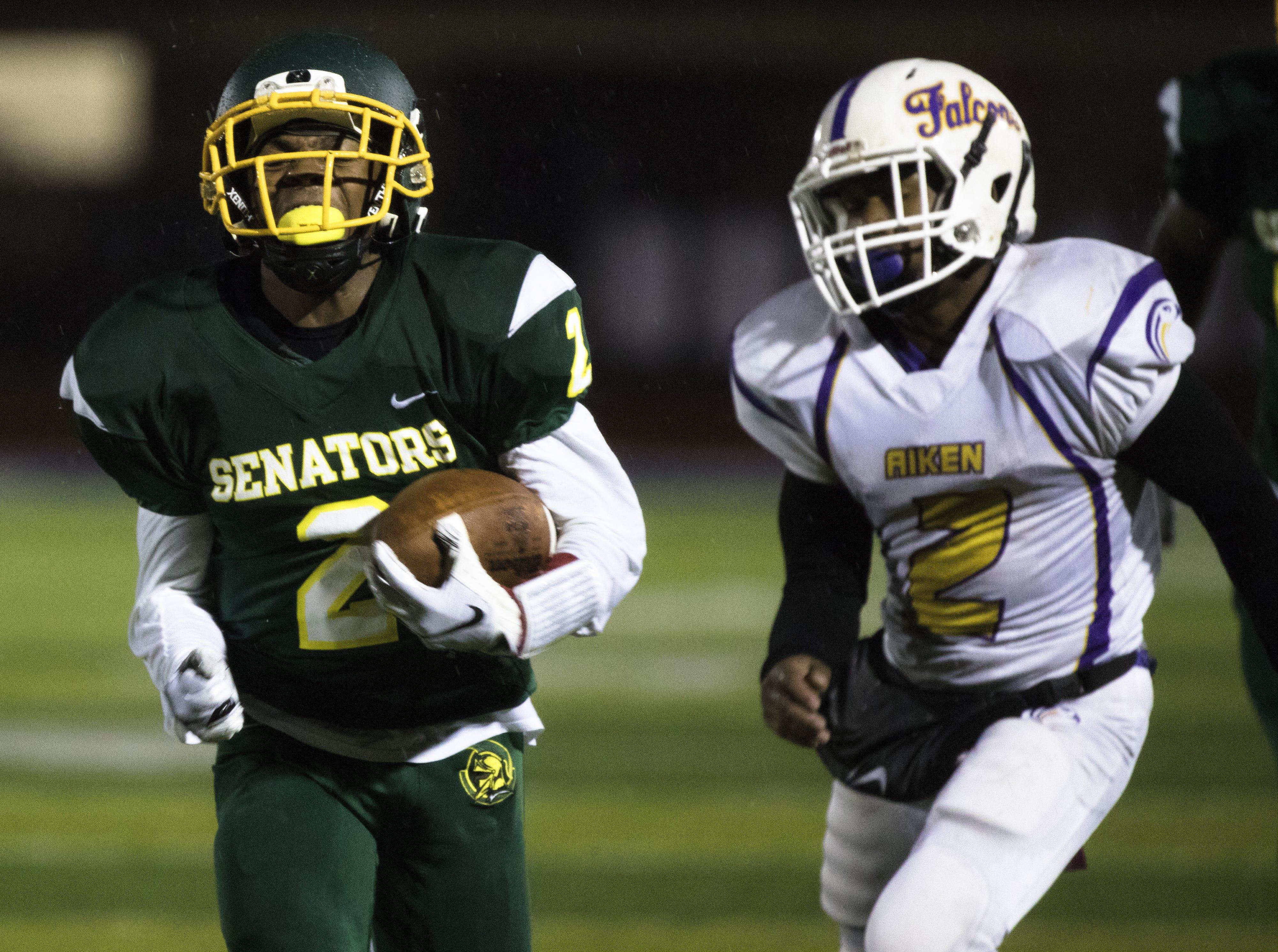 Taft's Demarco Bradley (2) scores a touchdown during the OHSAA final regular season game between Taft High School and Aiken High School on Friday, Oct. 26, 2018 at Stargel Stadium in the West End.